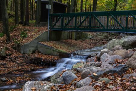Time exposure of a river called Ilsefaelle in the german region Harz Stockfoto - 131586595
