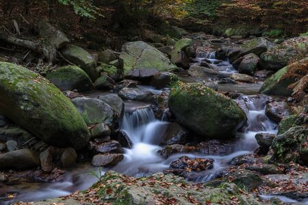 Time exposure of a river called Ilsefaelle in the german region Harz Stockfoto - 131586594