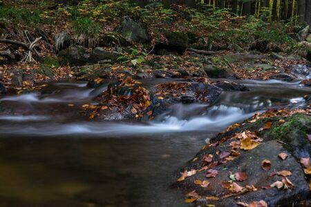 Time exposure of a river called Ilsefaelle in the german region Harz Stockfoto - 131586597
