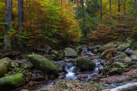 Time exposure of a river called Ilsefaelle in the german region Harz Stockfoto - 131586600