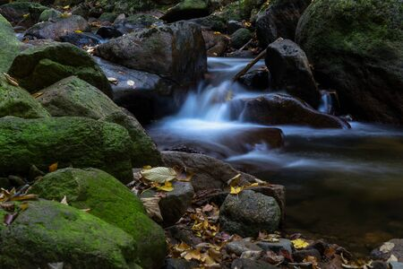 Time exposure of a river called Ilsefaelle in the german region Harz Stockfoto - 131586601
