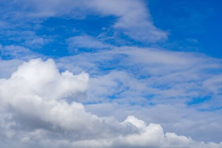 View in the autumn blue sky with some white clouds
