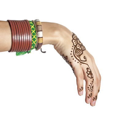 mehendi: Mehendi or henna tatoo on the female hands in bracelets isolated on white Stock Photo