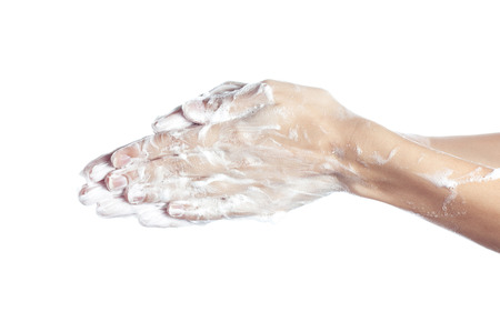 glycerin soap: Woman washes her hands. pictured female hands in soapsuds. Isolated on white