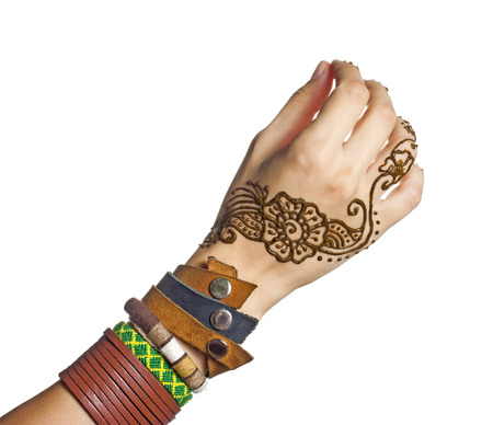 mehendi: Mehendi or henna tatoo on the female hands in bracelets isolated on white Stock Photo