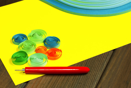 quilling: Bright colored background items for quilling (paper, pen, ruler)