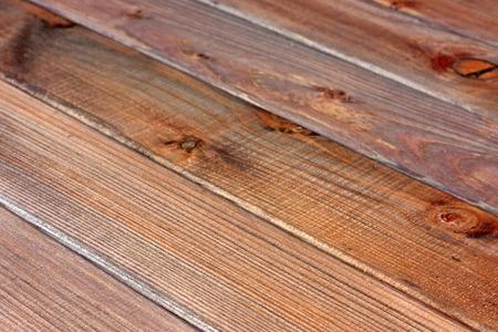 diagonals: Textured rustic wooden dark brown table background. Diagonals.