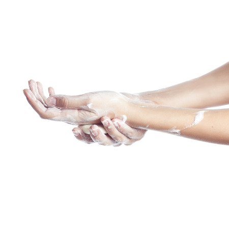 soaping: Woman washes her hands. pictured female hands in soapsuds. Isolated on white