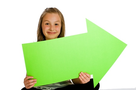 child holding sign: child holding a blank green arrow sign Stock Photo