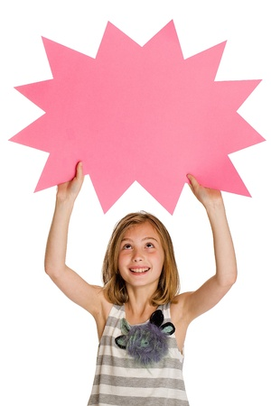 child holding pink sign in the shape of an explosion photo