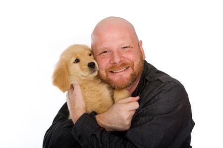 Mens en Puppy Stockfoto