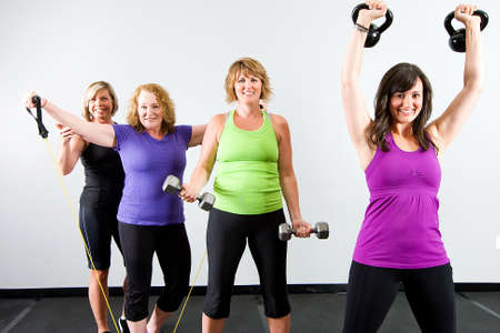 Women working out at a gym photo