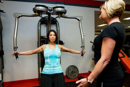 Personal Trainer at a gym Stock Photo - 10944727