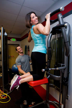 Woman working out with personal trainer photo