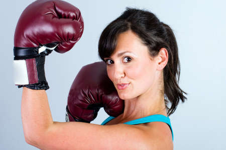 Female Boxer throwing an uppercut photo