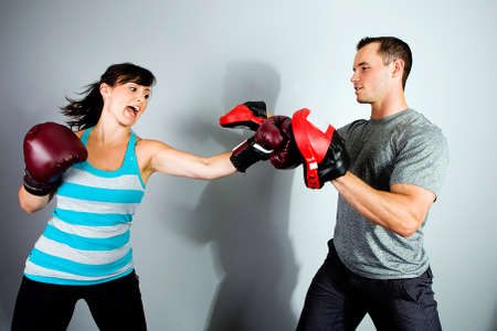 punched: female boxer in training