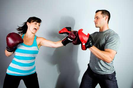 girl punch: female boxer in training