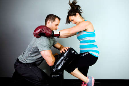 woman boxing gloves: Woman training to fight