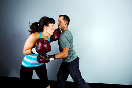 punching: Man and woman training for boxing match