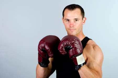 puncher: Handsome man wearing boxing gloves.