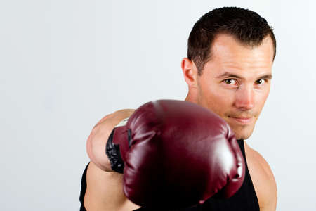 individual sport: Boxer throwing a punch