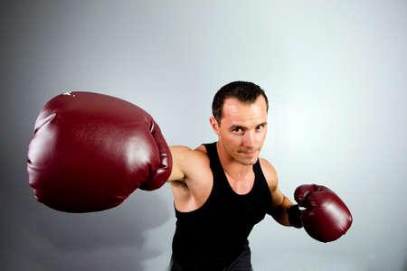Boxer throwing a right hook Фото со стока
