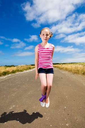 road shoulder: child jumping outside Stock Photo