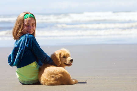 Child with her dog at the beach
