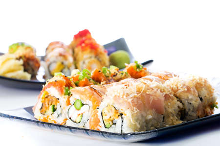 Sushi rolls with raw fish photo