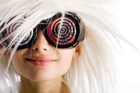 Funny looking kid with hypnotic glasses and a wild white wig.