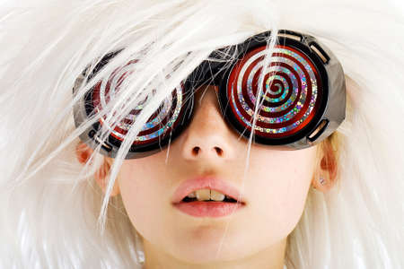 insane: weird looking kid with x-ray glasses and crazy white hair Stock Photo