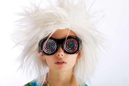 Weird looking kid with wild white wig and hypnotic glasses