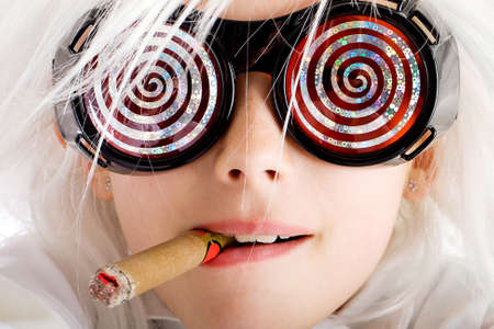 strange: crazy kid with hypnotic glasses smoking a cigar