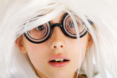 circle shape: child with thick, nerd glasses