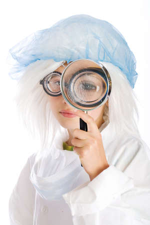 kid with a big eye in a magnifying glass photo