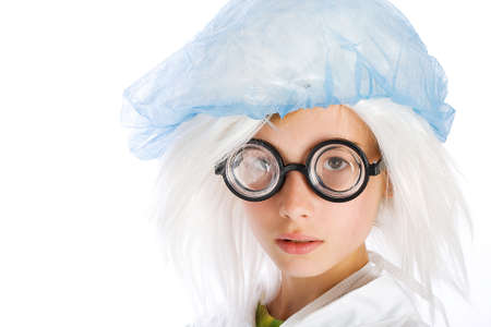 kid wearing nerd glasses and a surgical cap photo