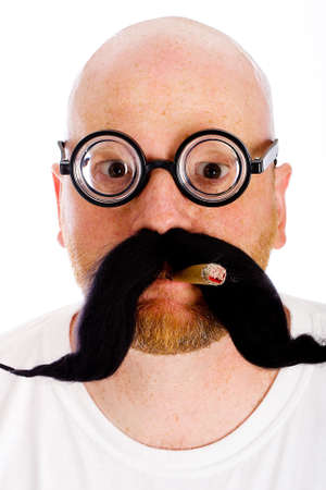 Bald man with nerd glasses and a fake mustache photo