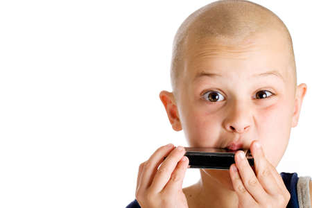shaved: young boy playing harmonica