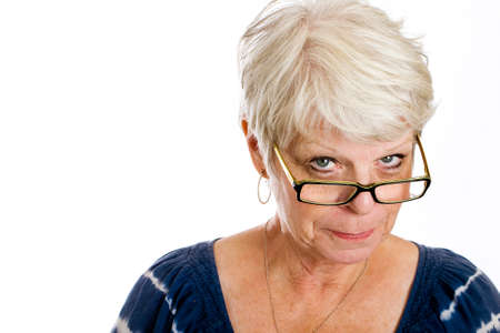 strict: wise, old woman looking over her glasses knowingly