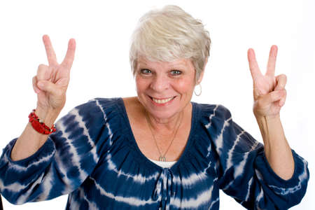 winning woman: mature woman giving peace sign