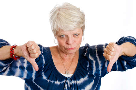 disapprove: sad, mature woman giving two thumbs down Stock Photo