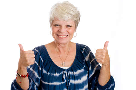 happy mature woman giving two thumbs up