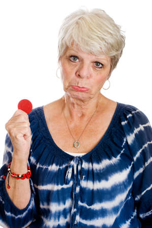 frown: Mature gambling woman down to her last poker chip