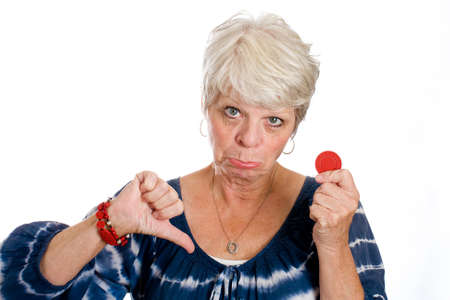 frown: Mature gambling woman with her last chip