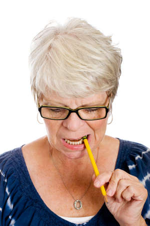 Mature woman chewing on a pencil photo