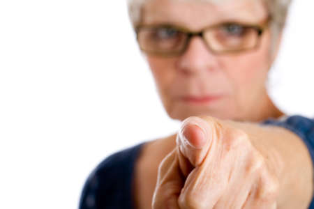 Mature woman pointing finger sternly