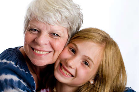 Happy mature woman hugging young girl photo