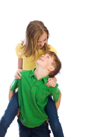 shoulder ride: Young boy playing with girl Stock Photo