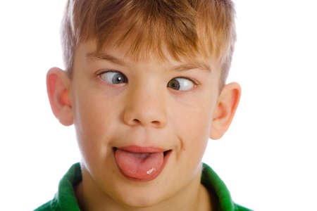 Funny young boy with a goofy expression