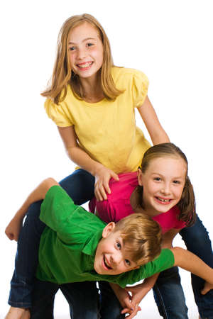 Group of young kids in colorful shirts having fun Stockfoto